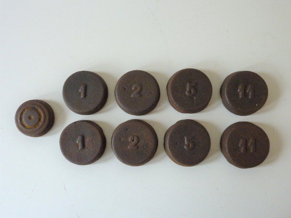 jeu de palets anciens en fonte